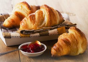 Fresh Croissants on   wooden background . Selective focus